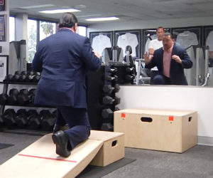 Brian working with a client in his training program