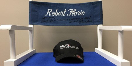 """Robert gave Brian his director's chair from the NCIS production. On it he wrote """"Dear Brian, thank you for saving and changing my life! With much love, Robert Florio""""."""
