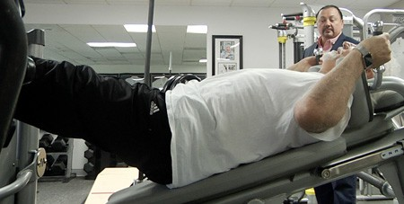 Brian works with every client individually in his private gym.